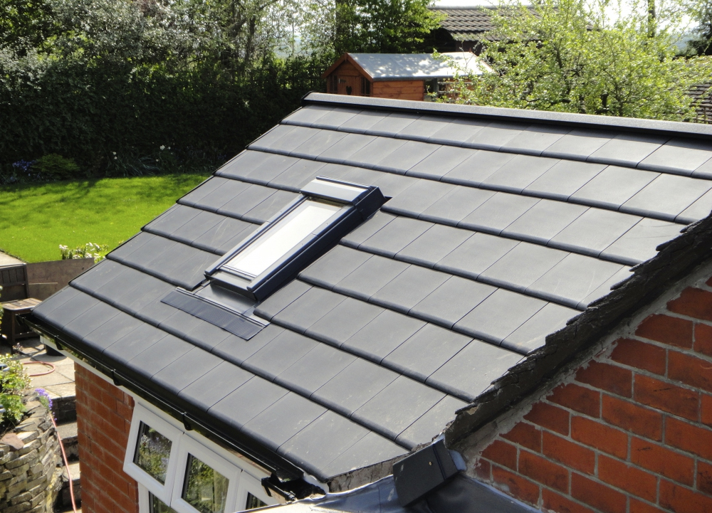 Tiled conservatory roof with Velux window