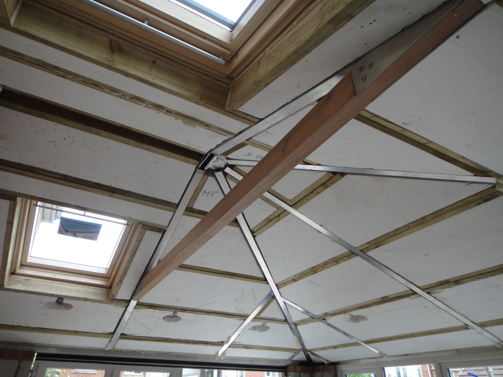 Conservatory roof during conversion to tiled slates