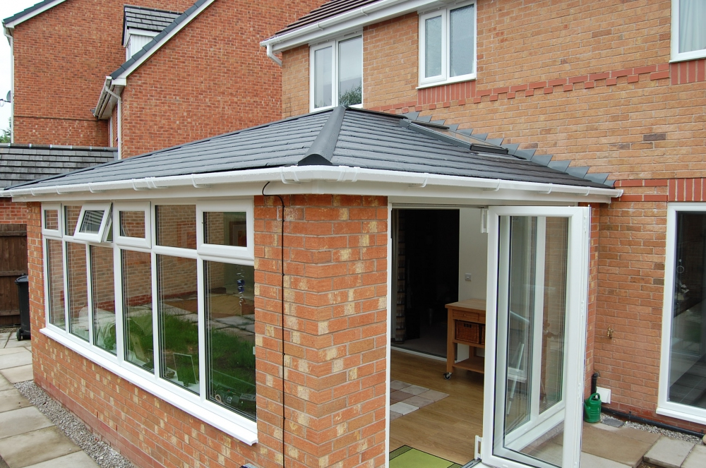 Converted conservatory with tiled slate roof